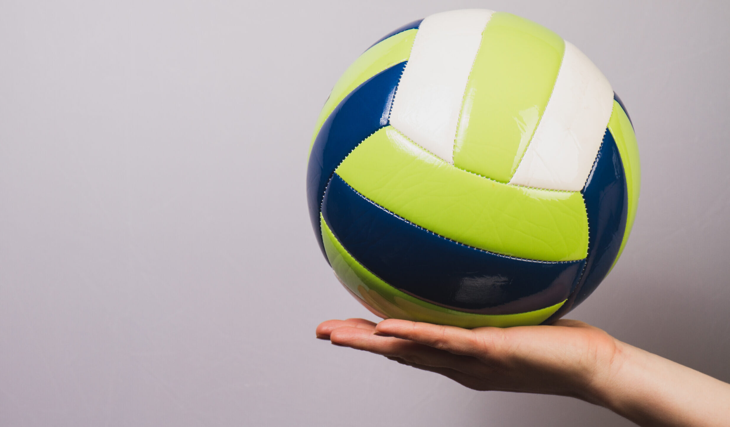 close-up-of-ball-on-hand-scaled-e1610889259912